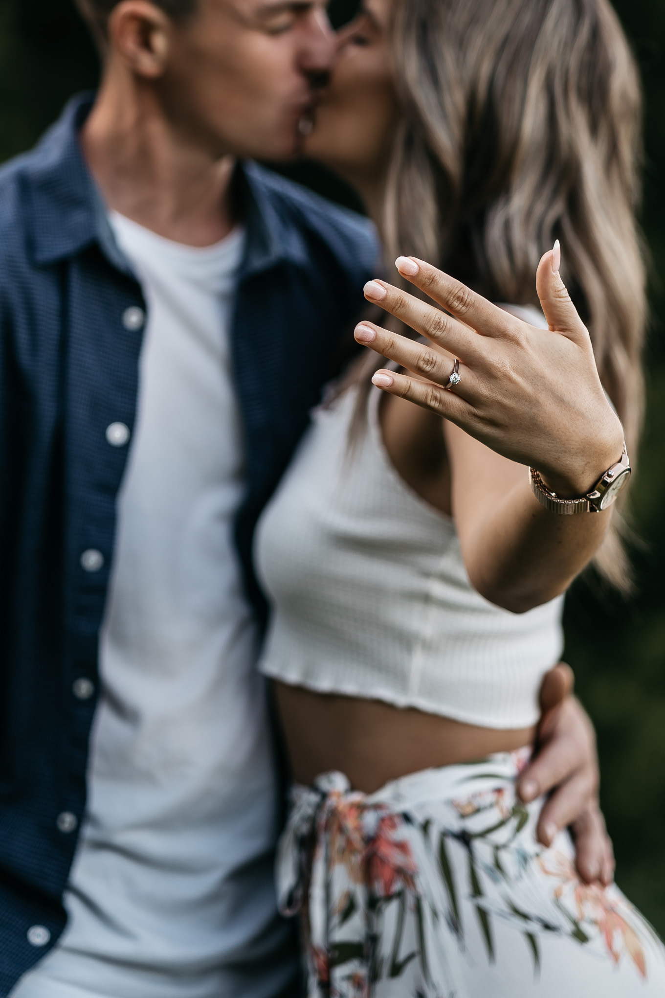 engaged couple showing ring